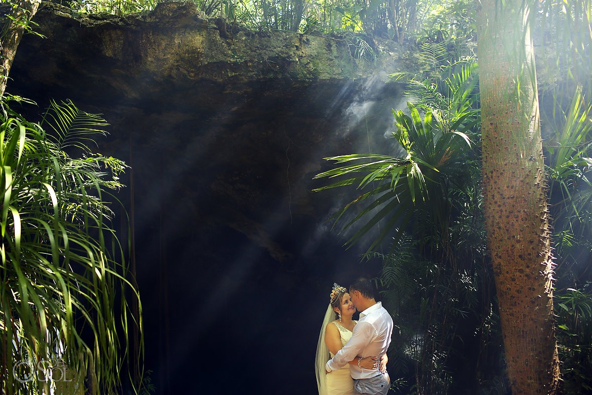 bride and groom loving life and nature Cenote Trash the Dress Riviera Maya Mexico.