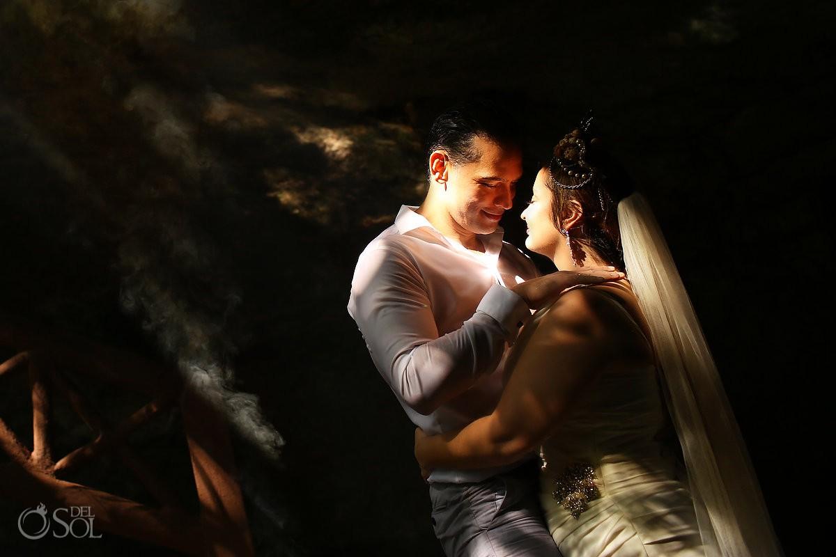 Sexy sun light bride and groom trash the dress portrait Riviera Maya Mexico.