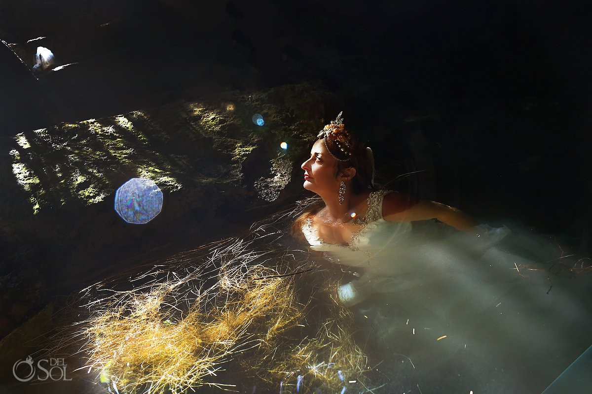 Beautiful colorful light flare bride portrait Cenote Trash the Dress Riviera Maya Mexico.