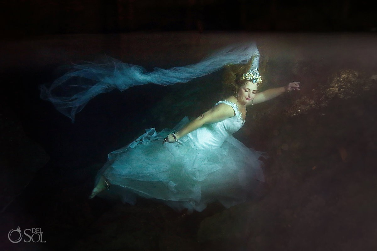 Colorful underwater trash the dress bride portrait Cenote Trash the Dress Riviera Maya Mexico.