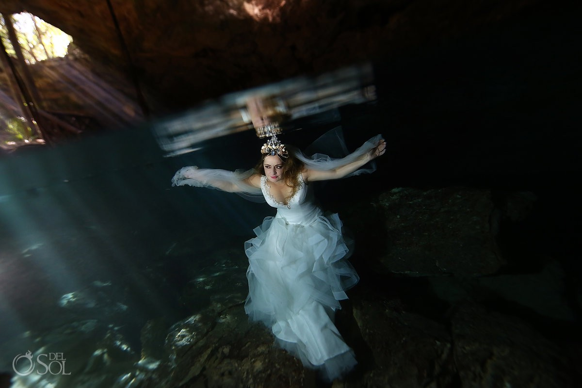 Beautiful wedding dress underwater Trash the Dress Riviera Maya Mexico.