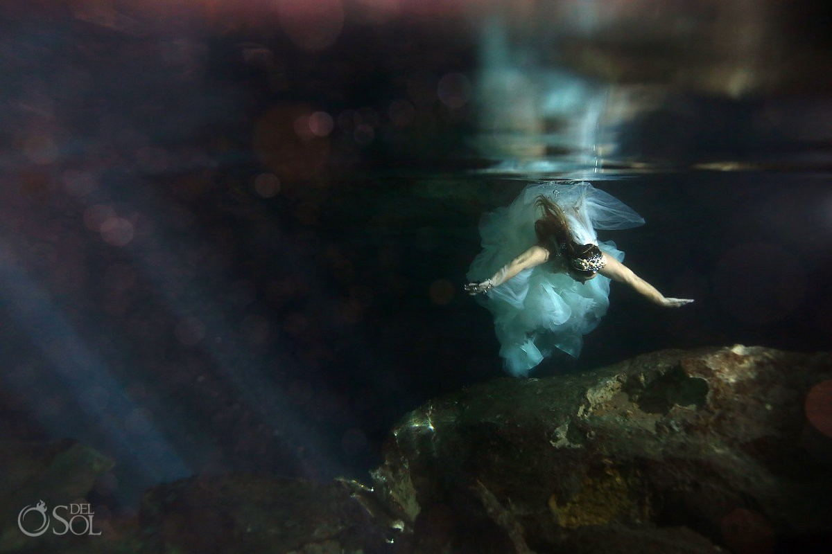 Bride underwater reflection Cenote Trash the Dress Riviera Maya Mexico.