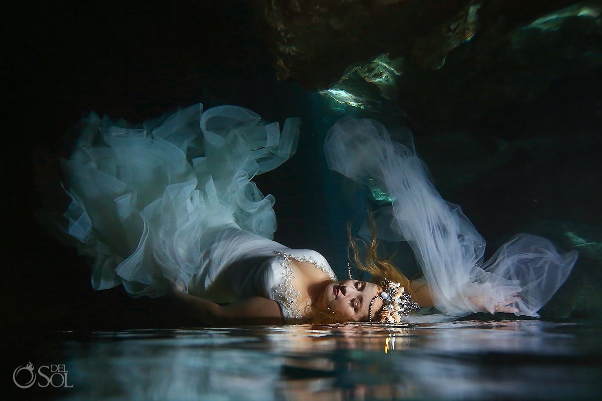 Amazing bride underwater bride reflection artistic portrait Cenote Trash the Dress Riviera Maya Mexico.