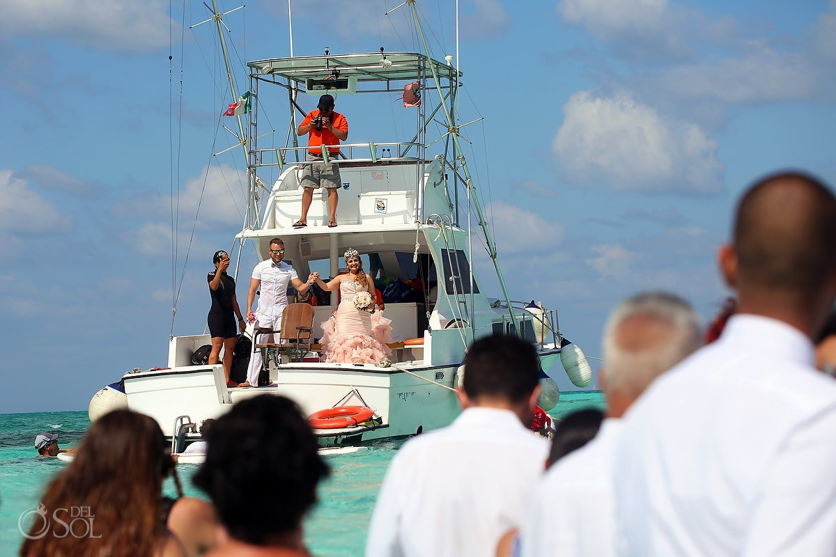 Bride entrance on boat wearing pink Maggie Socorro Wedding dress El Cielo Cozumel Mexico