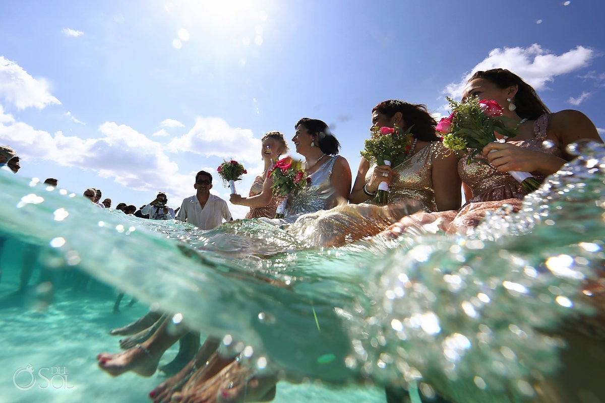 bride maids enjoying underwater beach wedding el Cielo Cozumel Mexico.
