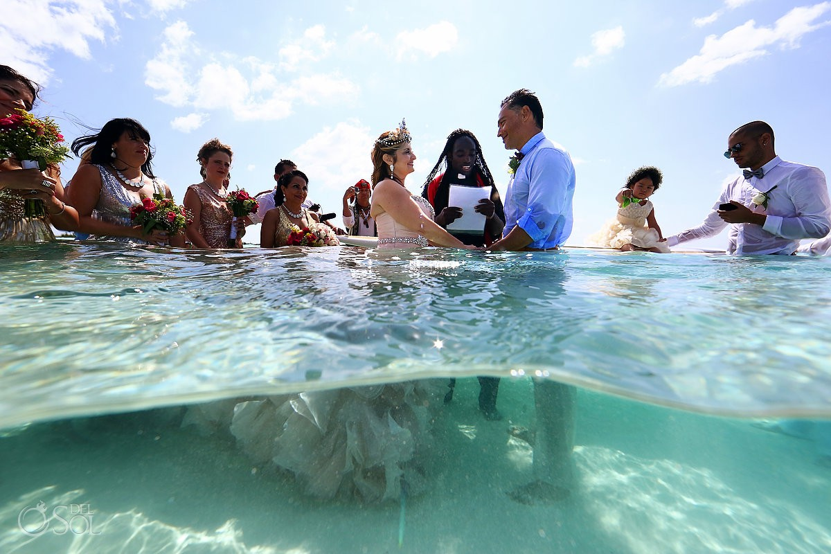 Destination wedding el Cielo Cozumel Mexico ceremony in the water