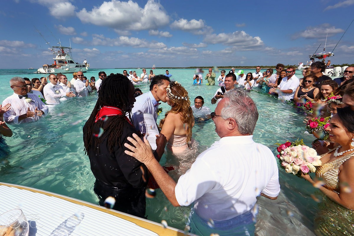 First kiss destination wedding water el Cielo Cozumel Mexico