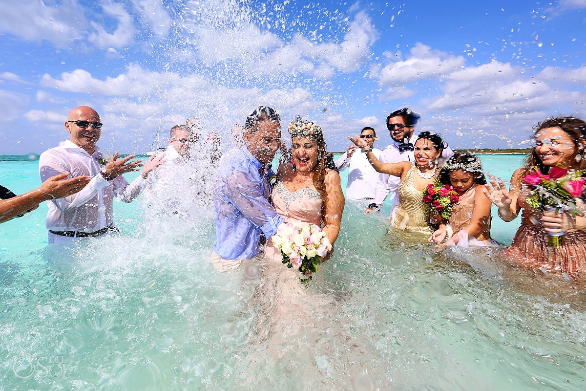 wedding celebration splashing water bride and groom el Cielo Cozumel Mexico