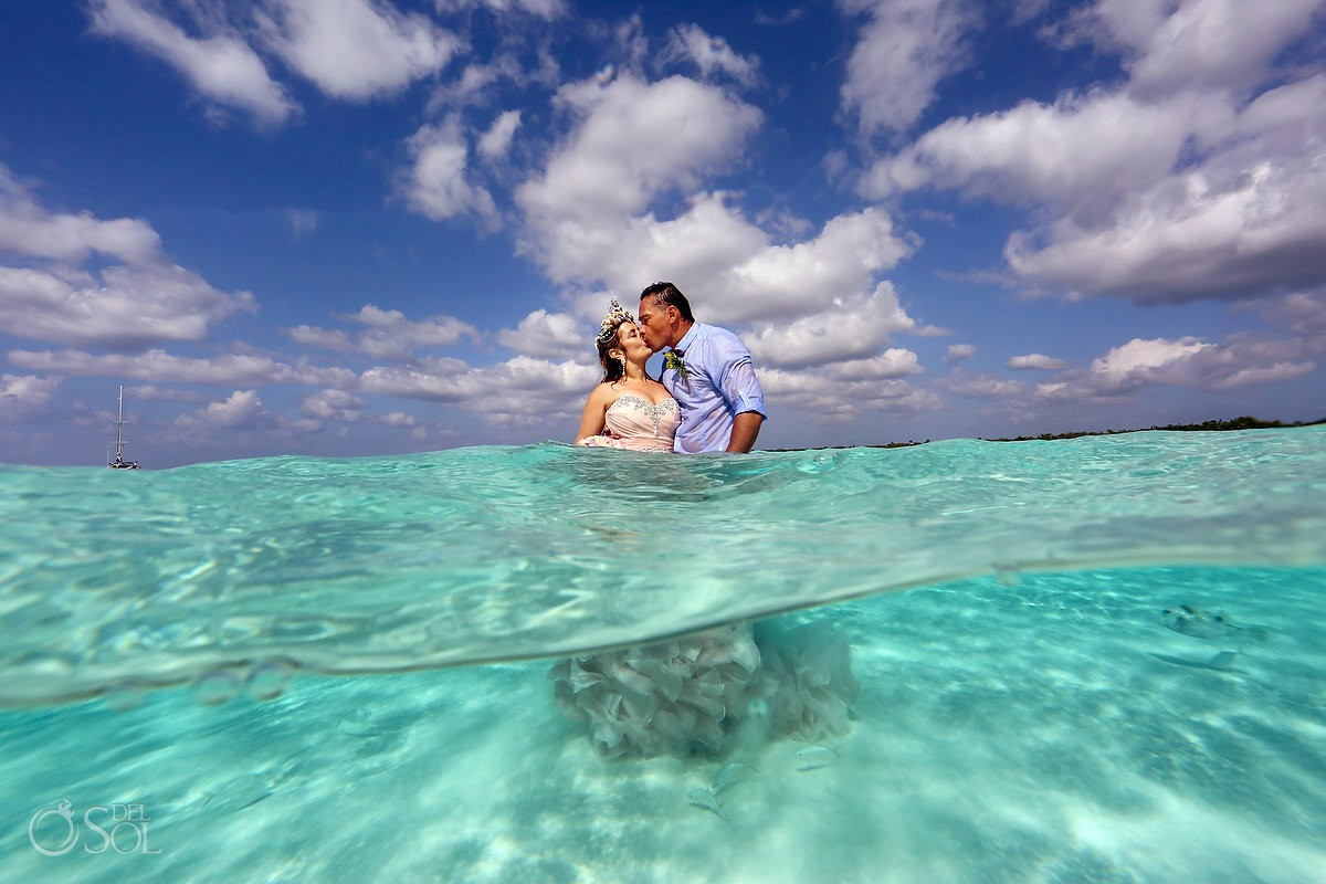 Romantic kiss middle of the ocean destination wedding el Cielo Cozumel Mexico