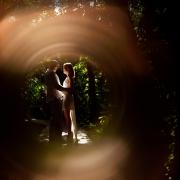 Honeymoon couple portrait inside a ring of fire