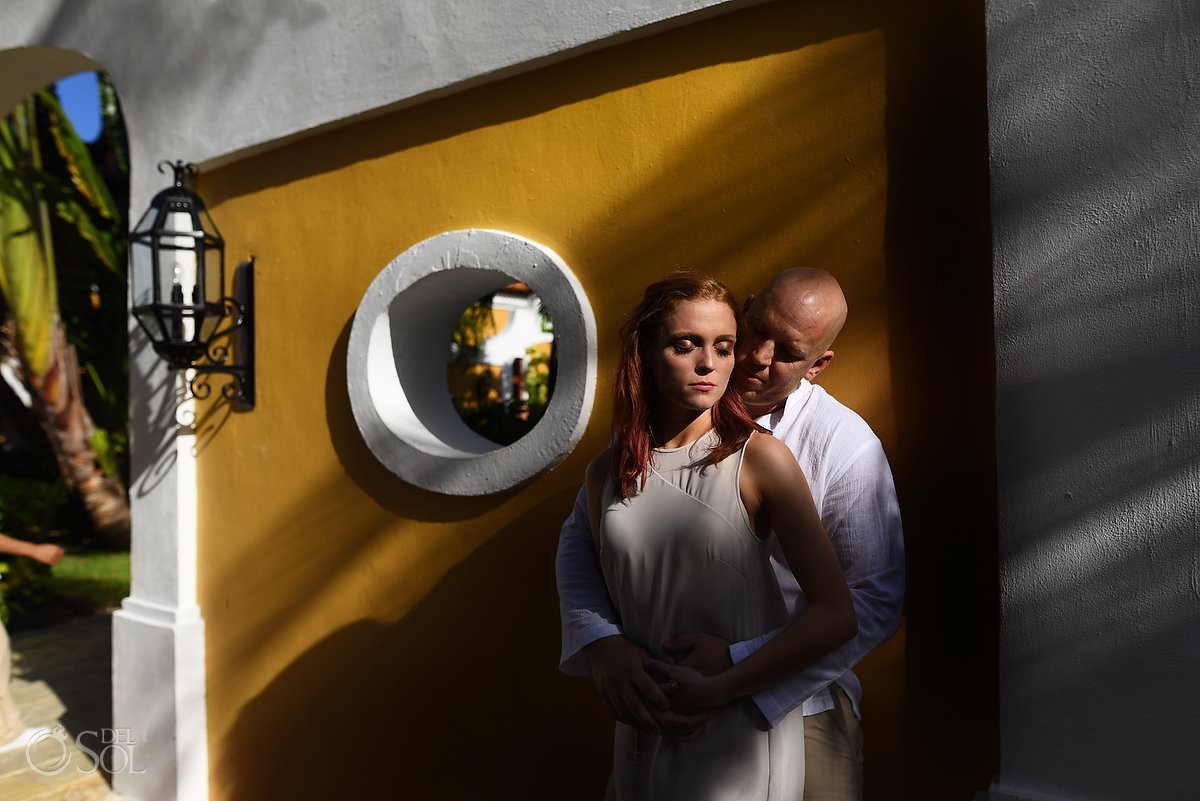 Romantic honeymoon photograph shadow and light colonial architecture yellow wall Dreams Tulum Mexico