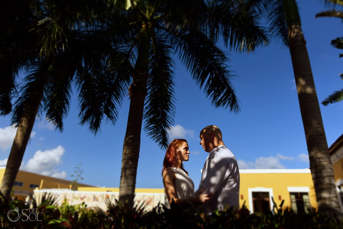 couple between palm trees shadows picture honeymoon portraits session Dreams Tulum Mexico