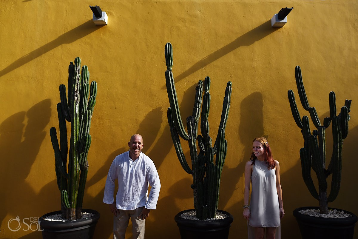 fun colorful Honeymoon portraits session idea yellow wall cactus Dreams Tulum Mexico