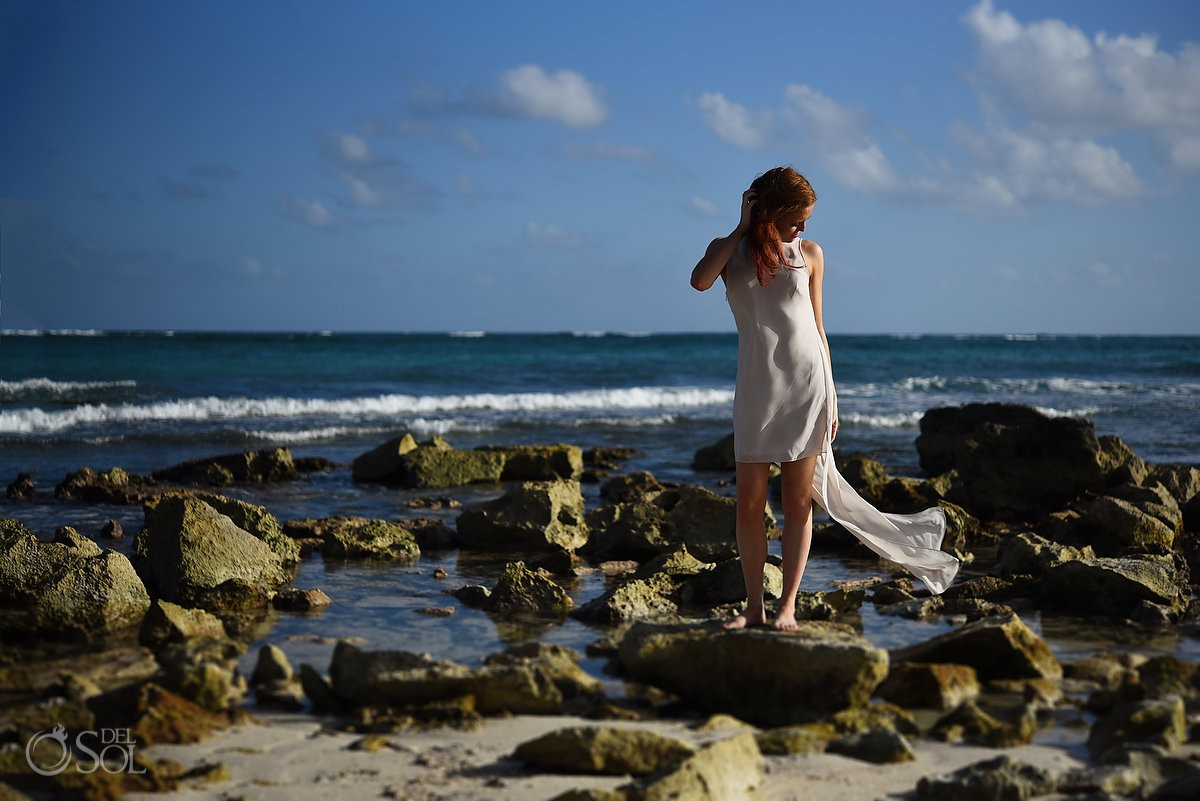Honeymoon portraits bride beach picture red hair blowing in the wind Dreams Tulum rocky beach Riviera Maya Mexico