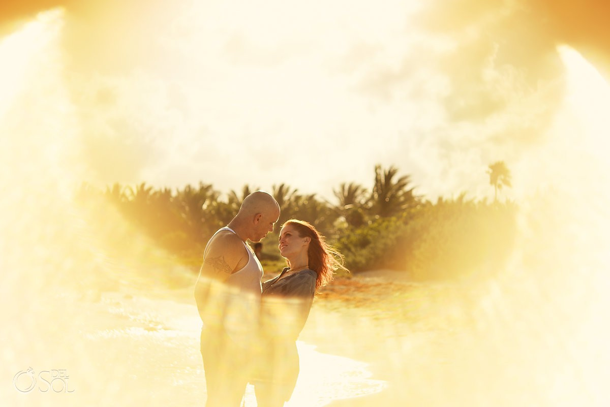 Sunset golden hour flare picture honeymooning couple surrounded by warm light honeymoon portraits Dreams Tulum beach Riviera Maya Mexico
