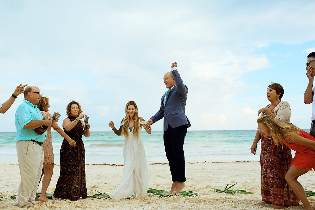 Just married bride and groom jumping happiness Cabañas La Luna Tulum Mexico