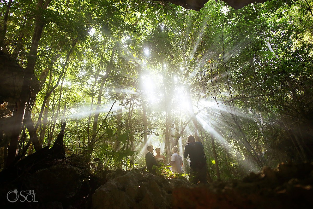 Beautiful light under jungle spiritual ceremony cenote Aktun Chen, Mexico