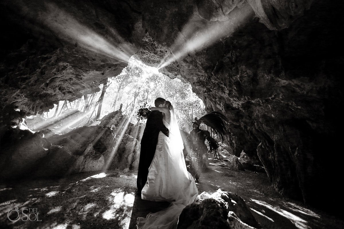Amazing light entrance bride and groom portrait cenote Aktun Chen, Mexico