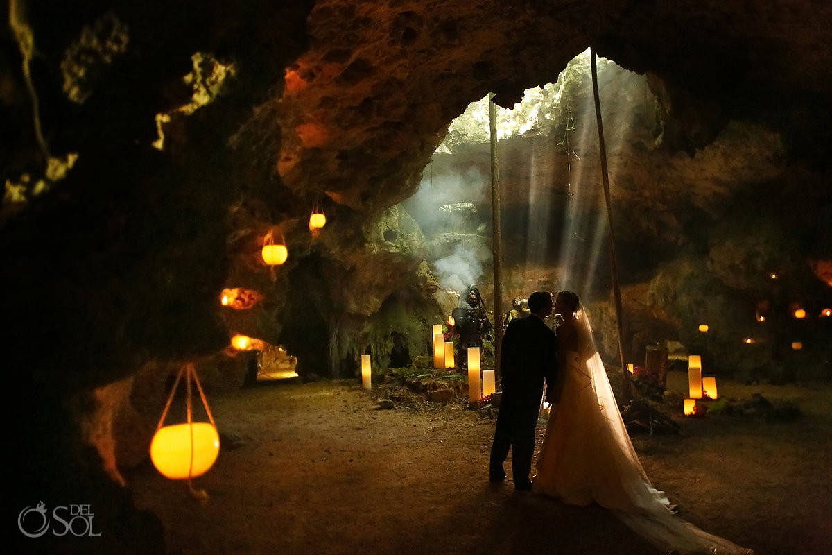 Romantic bride and groom portrait cenote Aktun Chen, Mexico