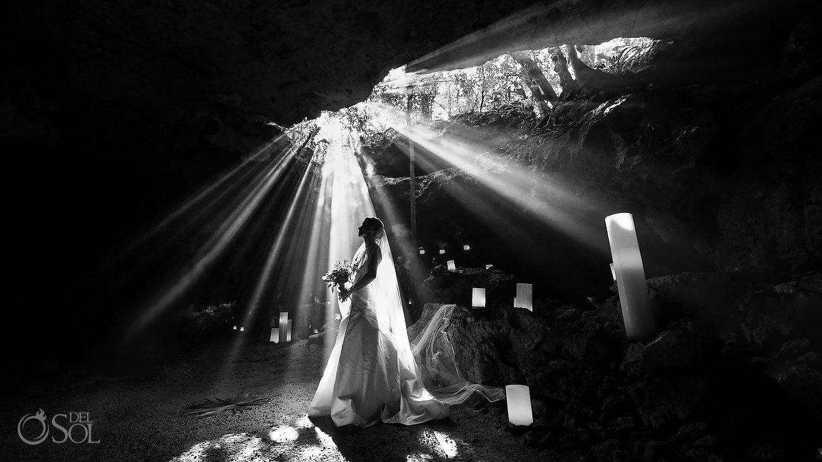 Creative black and white bride portrait cenote Aktun Chen, Mexico