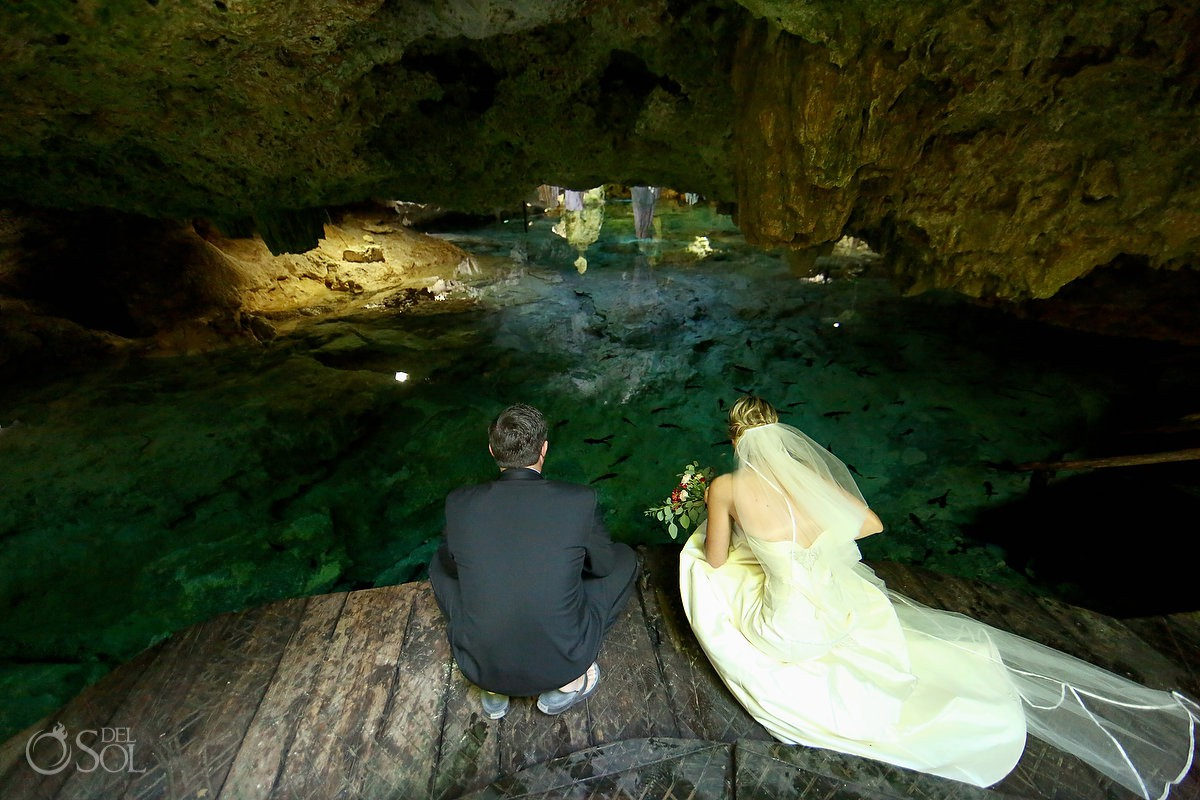 Bride and groom getting ready trash the dress cenote Aktun Chen, Mexico
