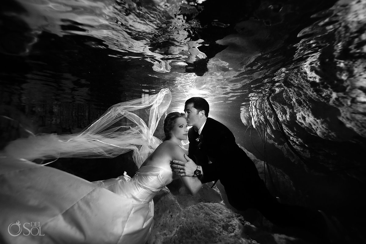 Bride and groom amazing black and white portrait trash the dress cenote Aktun Chen, Mexico