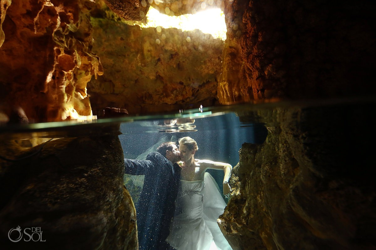amazing underwater cave romantic portraits trash the dress cenote Aktun Chen, Mexico