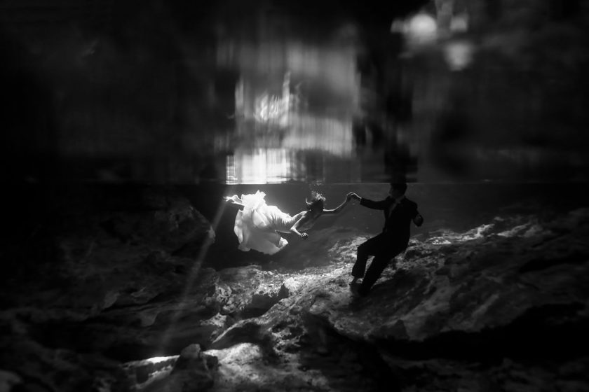 Black and white underwater portrait trash the dress cenote Aktun Chen, Mexico