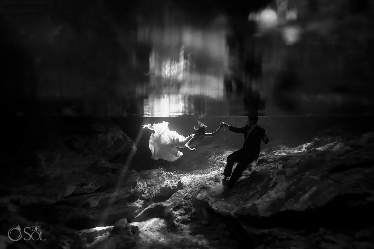 Black and white underwater portrait trash the dress cenote Aktun Chen, Mexico