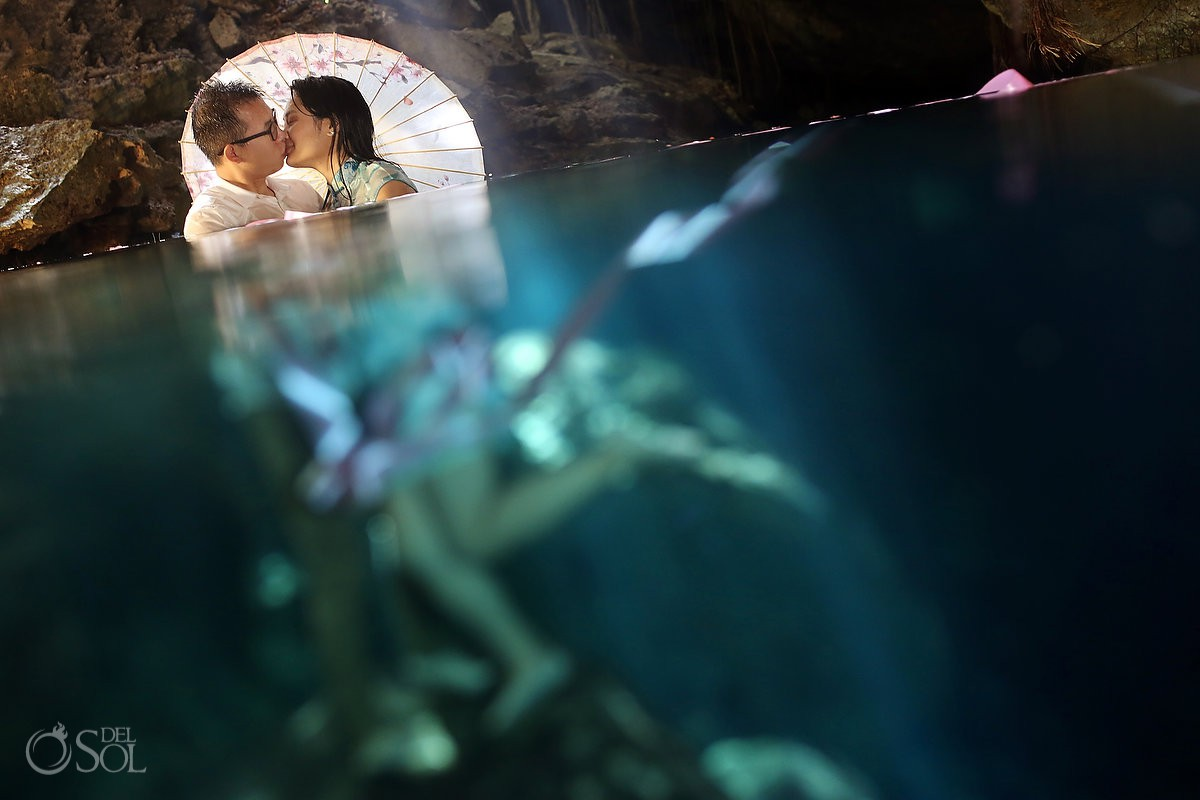 #Aworldofitsown Underwater Bride with parasol cenote trash the dress