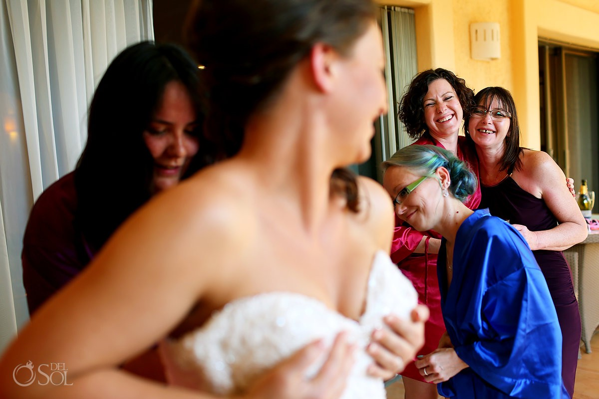 Bridesmaids having fun getting ready Destination Wedding Barceló Maya Palace Riviera Maya Mexico.
