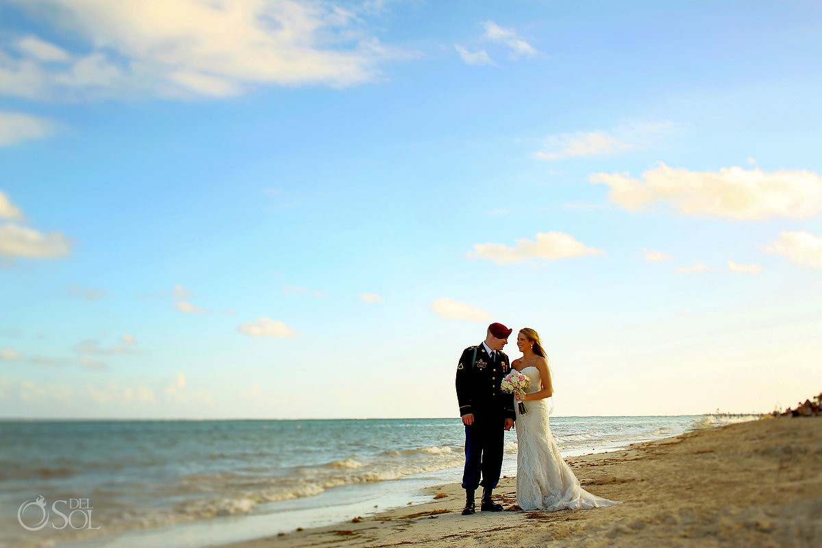 Bride and groom walking beach destination wedding Now Sapphire Riviera Maya México