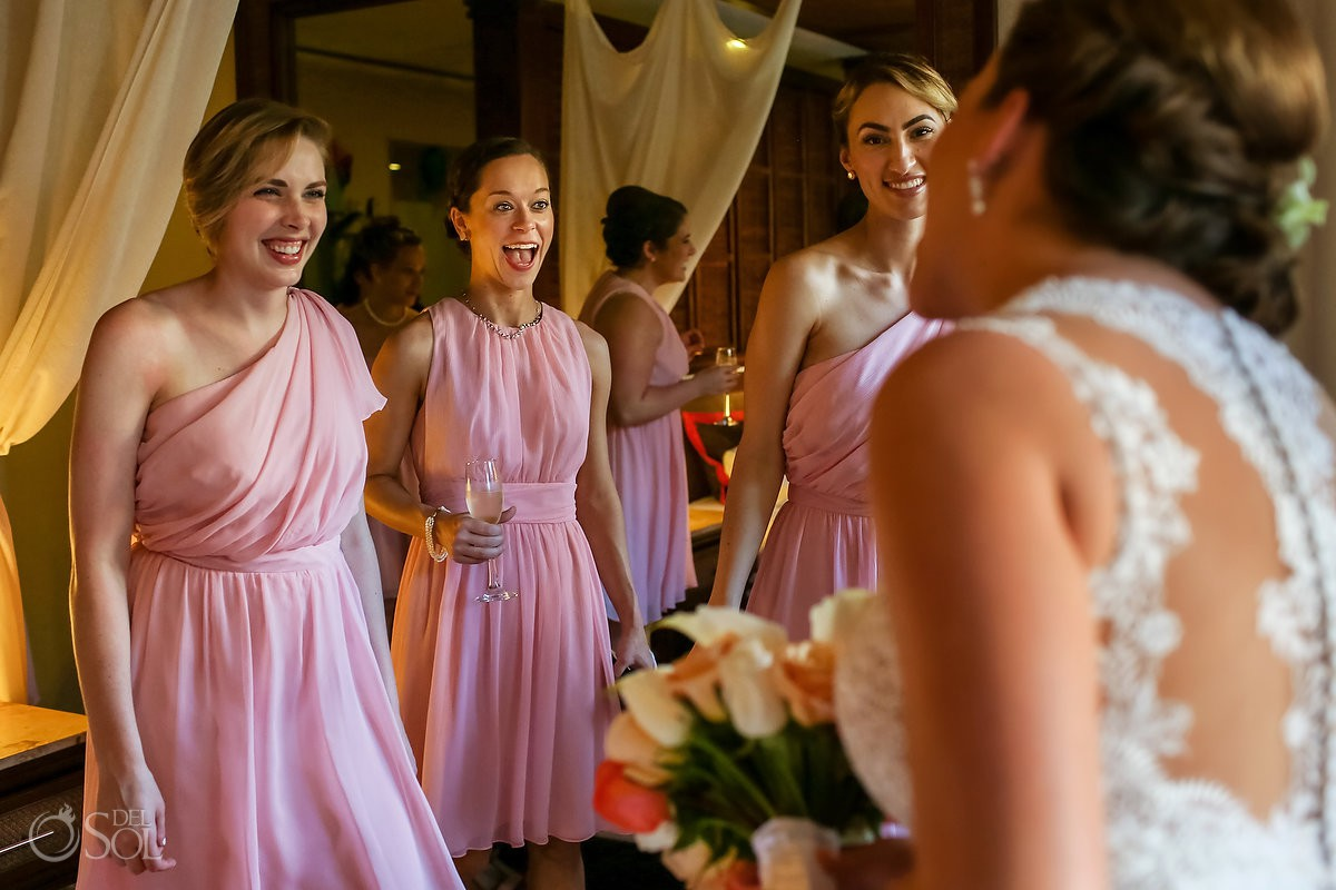 candid getting ready moment happy bridesmaids wearing pink dresses destination wedding Dreams Riviera Cancun Resort Mexico