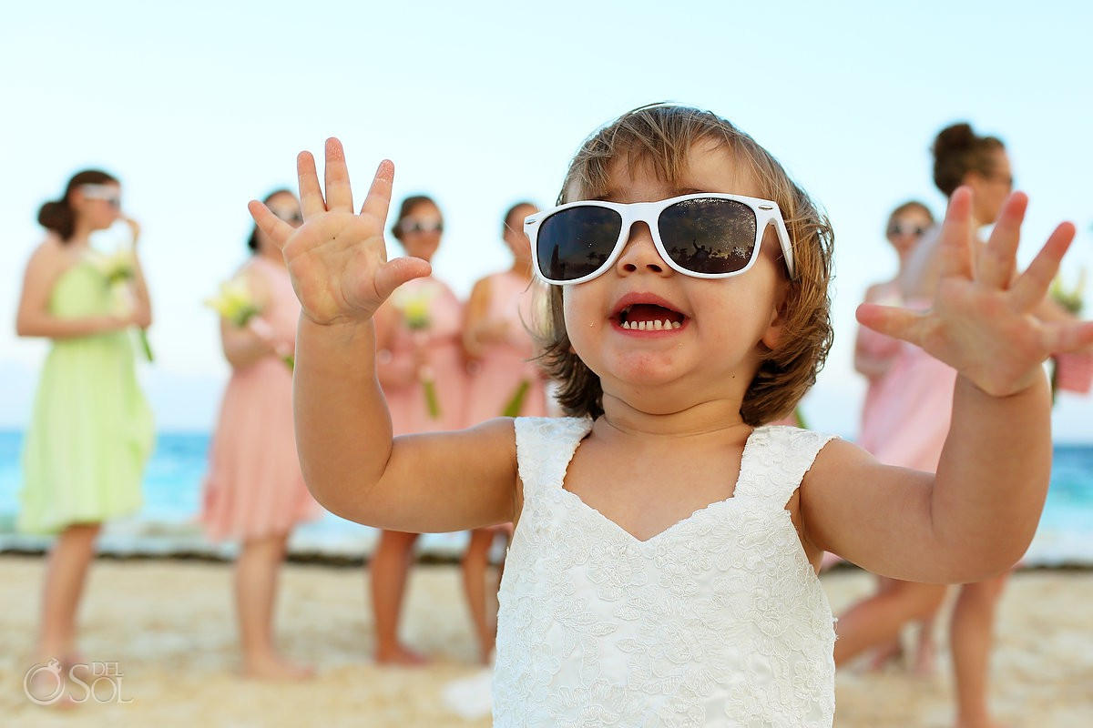 cute flowergirl wearing sunglasses destination wedding Dreams Riviera Cancun Resort Mexico