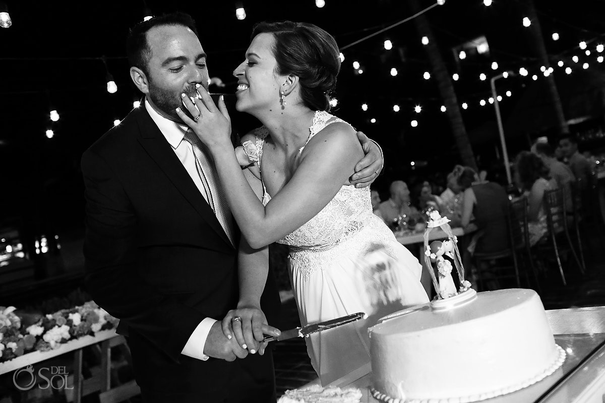 cake cutting Dreams Riviera Cancun pool deck wedding reception bride groom Mexico