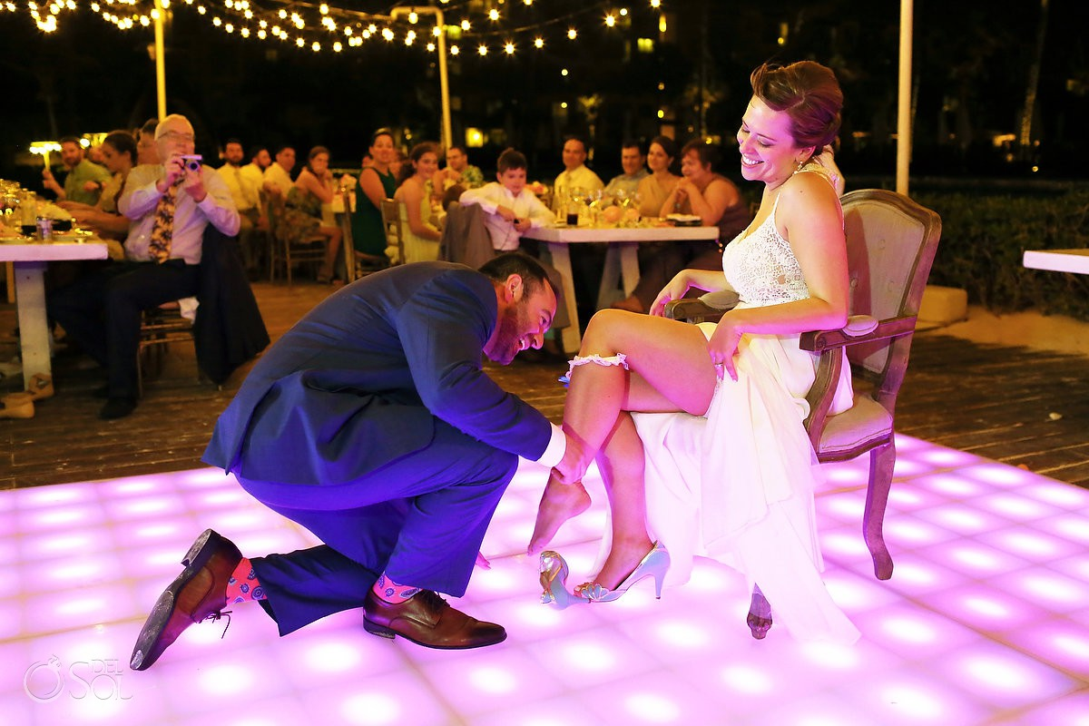 garter toss Dreams Riviera Cancun pool deck wedding reception bride groom Mexico