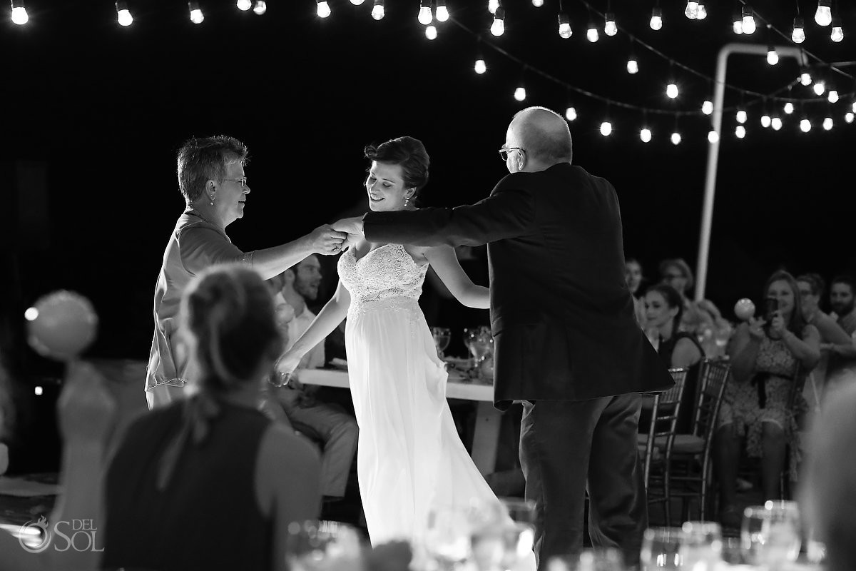 mother father first dance Dreams Riviera Cancun pool deck wedding reception Mexico