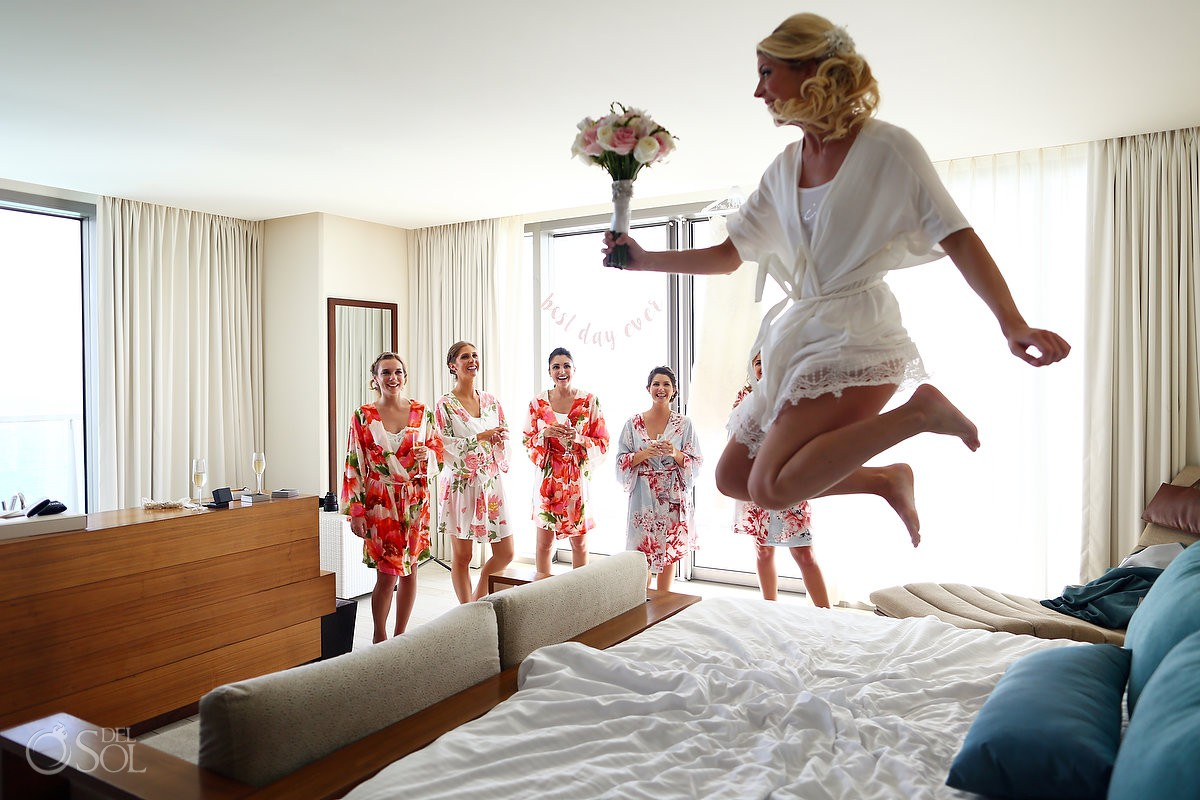 Bride and bridesmaids having fun getting ready before wedding ceremony Secrets the Vine AM Resorts Mexico.