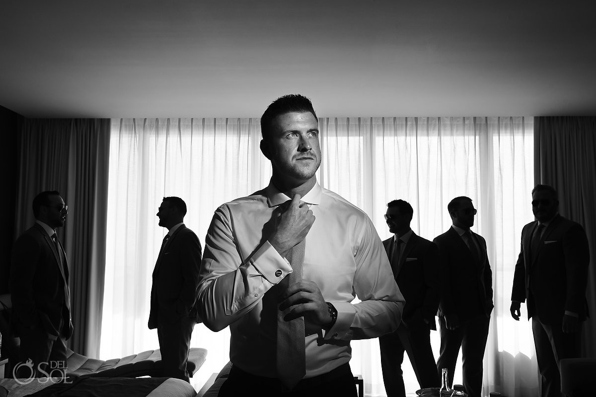 groom getting ready black and white portrait Destination Wedding at Secrets the Vine Cancun Mexico