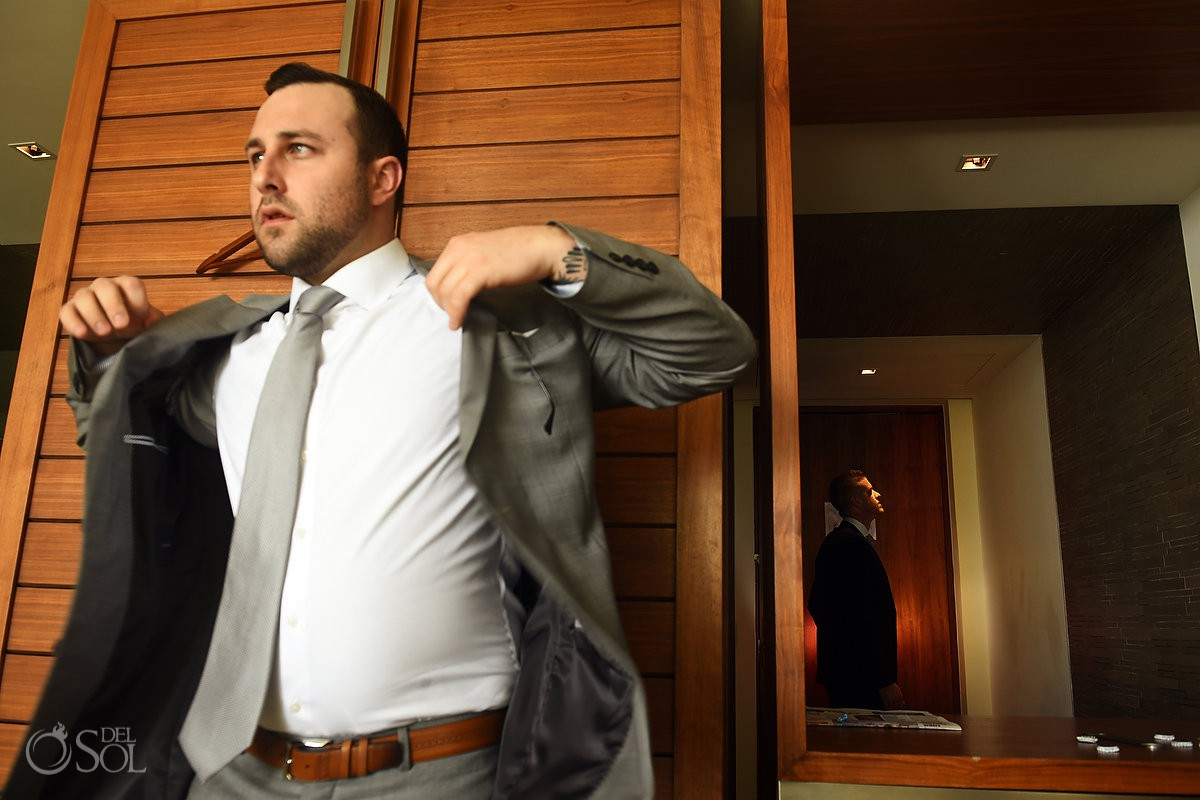 Groom and groomsman getting ready artistic portrait Secrets the Vine AM Resorts Mexico.