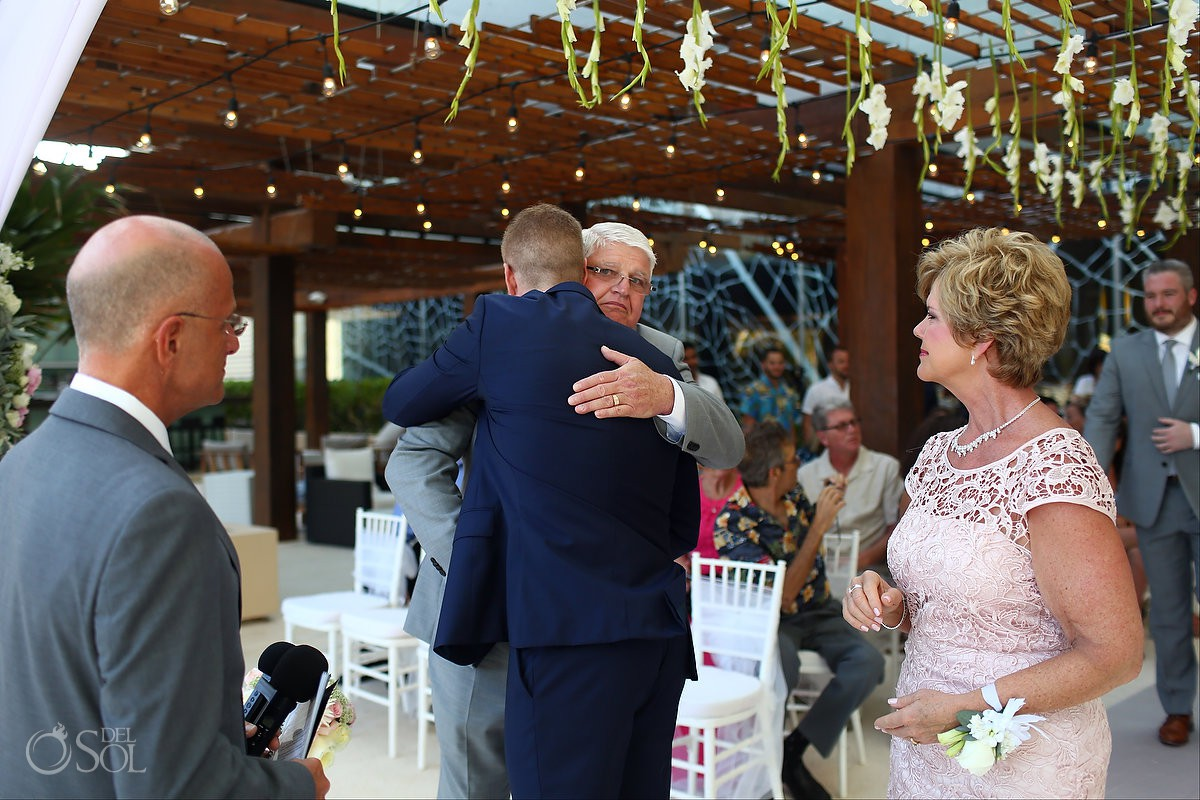 mother and father giving away groom emotional moments destination wedding Secrets the Vine, AM Resorts, Mexico.