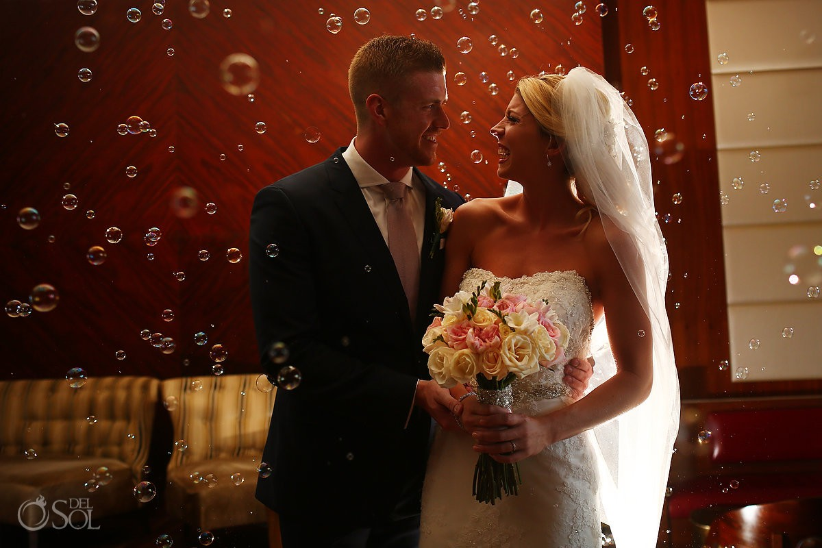Bride and groom portrait bubbles of love Secrets the Vine AM Resorts Mexico.