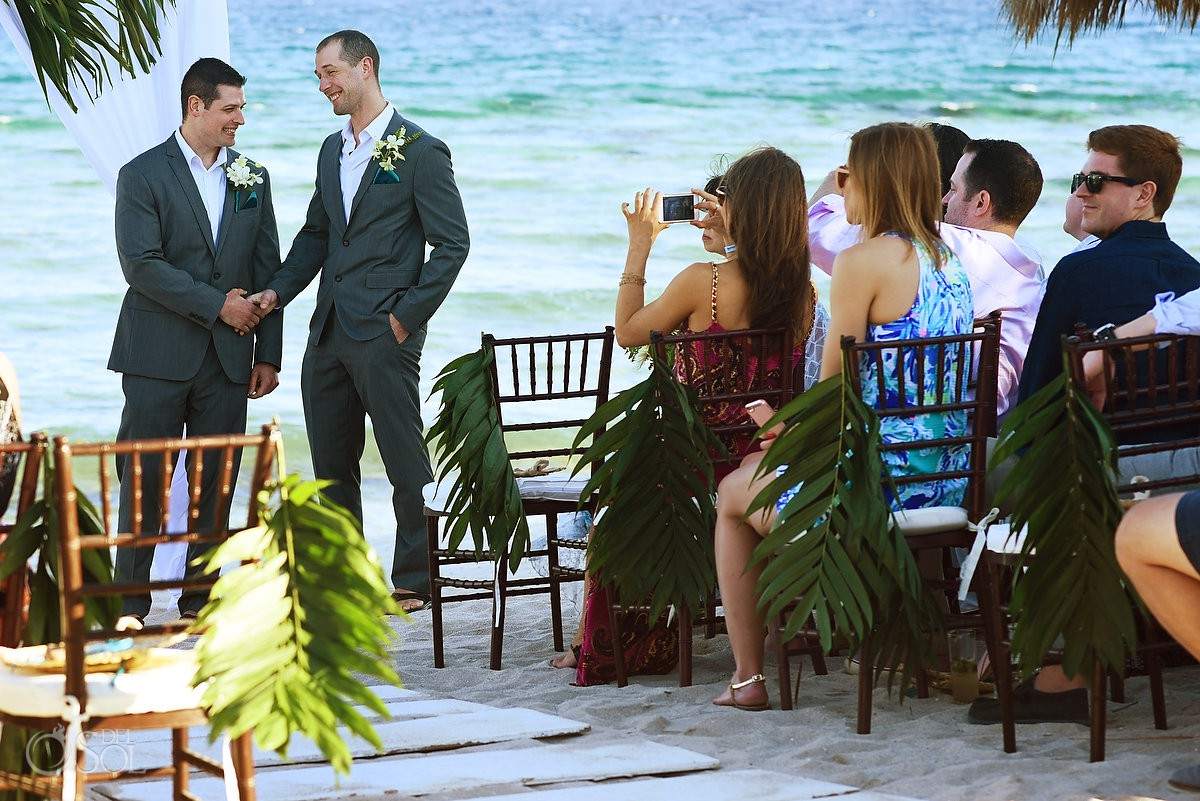 Groom and best man wedding ceremony beach wedding Blue Venado Beach Club Playa del Carmen Mexico.
