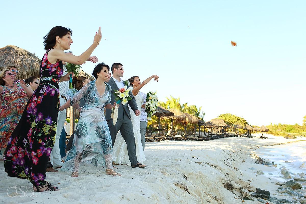 guest throwing snails guest wishes Blue Venado Beach Club Playa del Carmen Mexico.