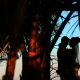 creative silhouette bride and groom beach portraits Blue Venado Beach Club Playa del Carmen Mexico.