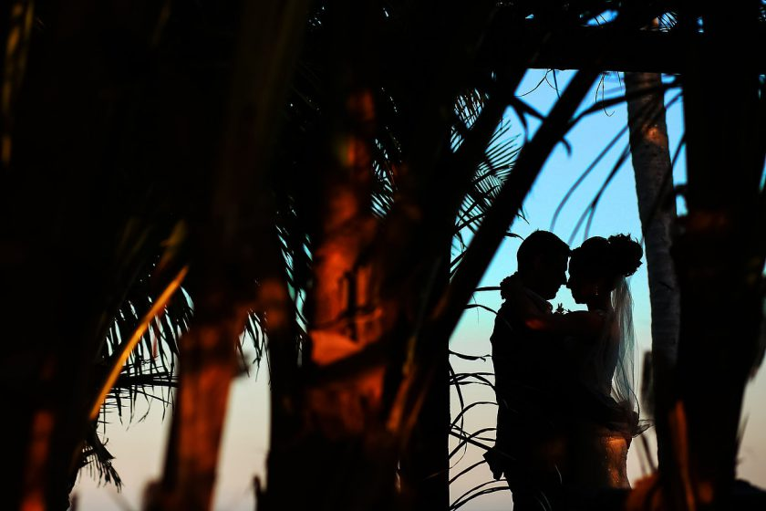 creative silhouette bride and groom beach portraits Blue Venado Beach Club Playa del Carmen Mexico.