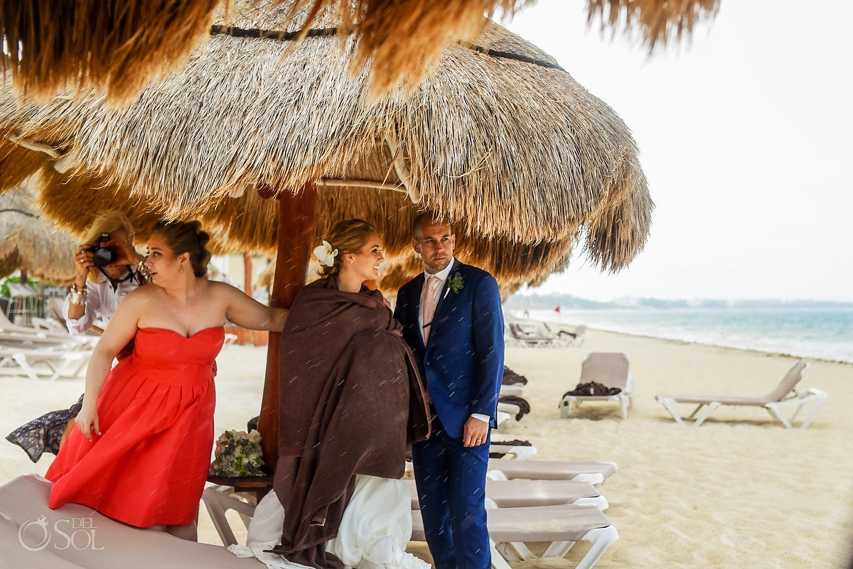 wedding rain bride and groom hiding Now Sapphire Puerto Morelos Mexico