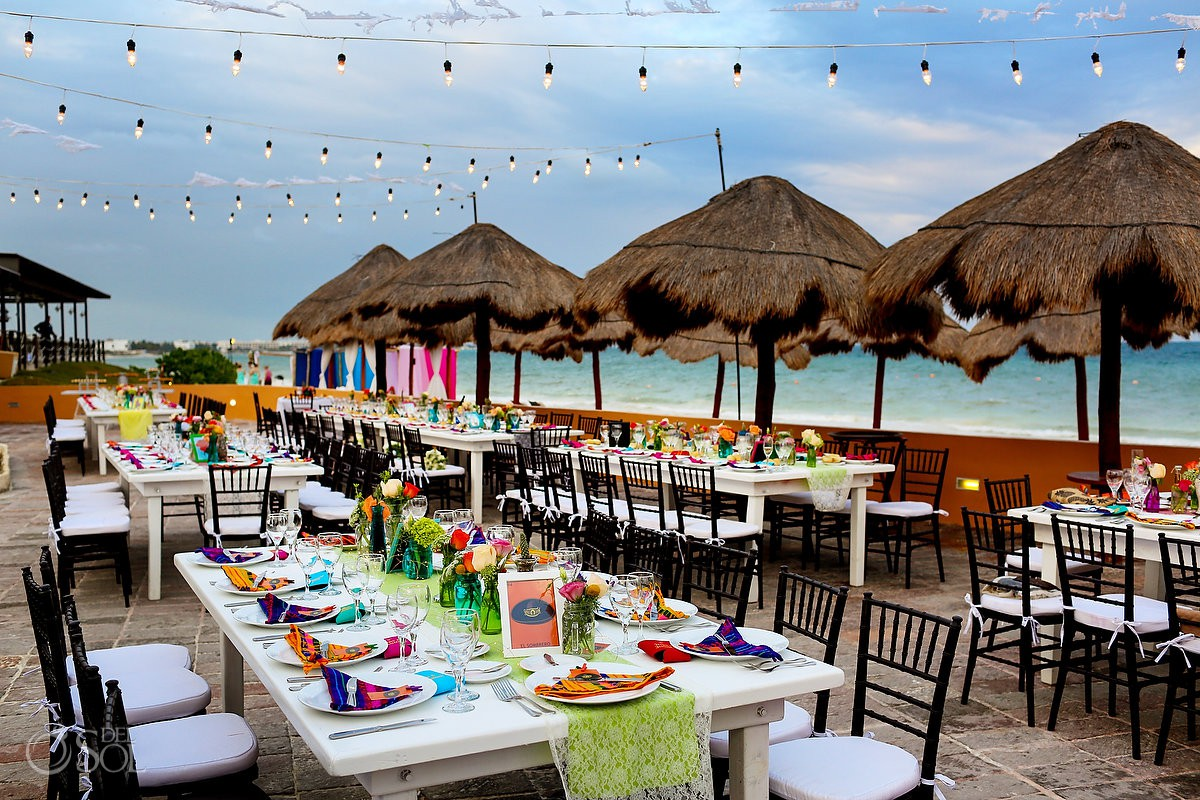 Beach terrace colorful set up destination wedding reception Now Sapphire Puerto Morelos Mexico