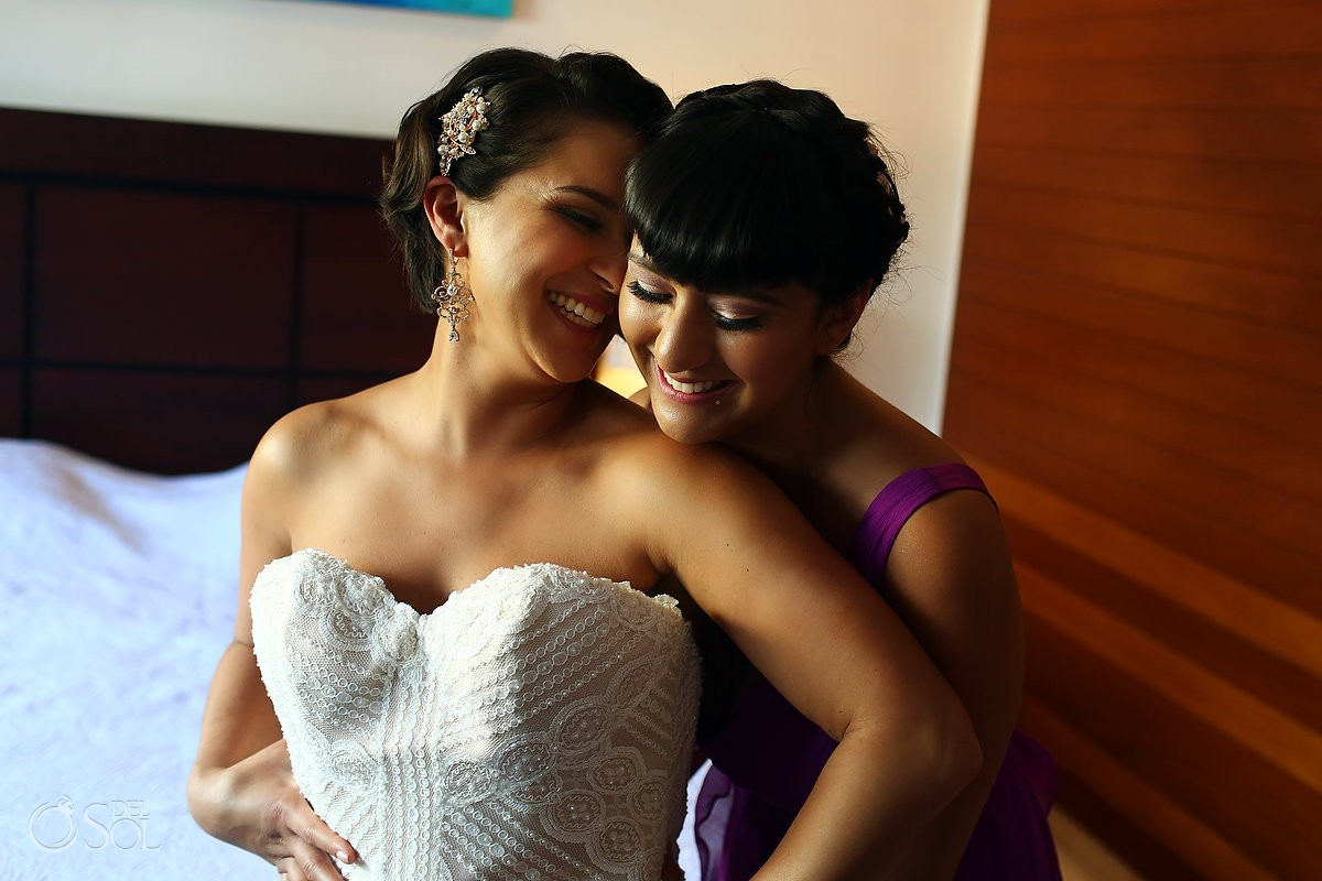 Bride and sister getting ready for the ceremony Playa del Carmen Mexico