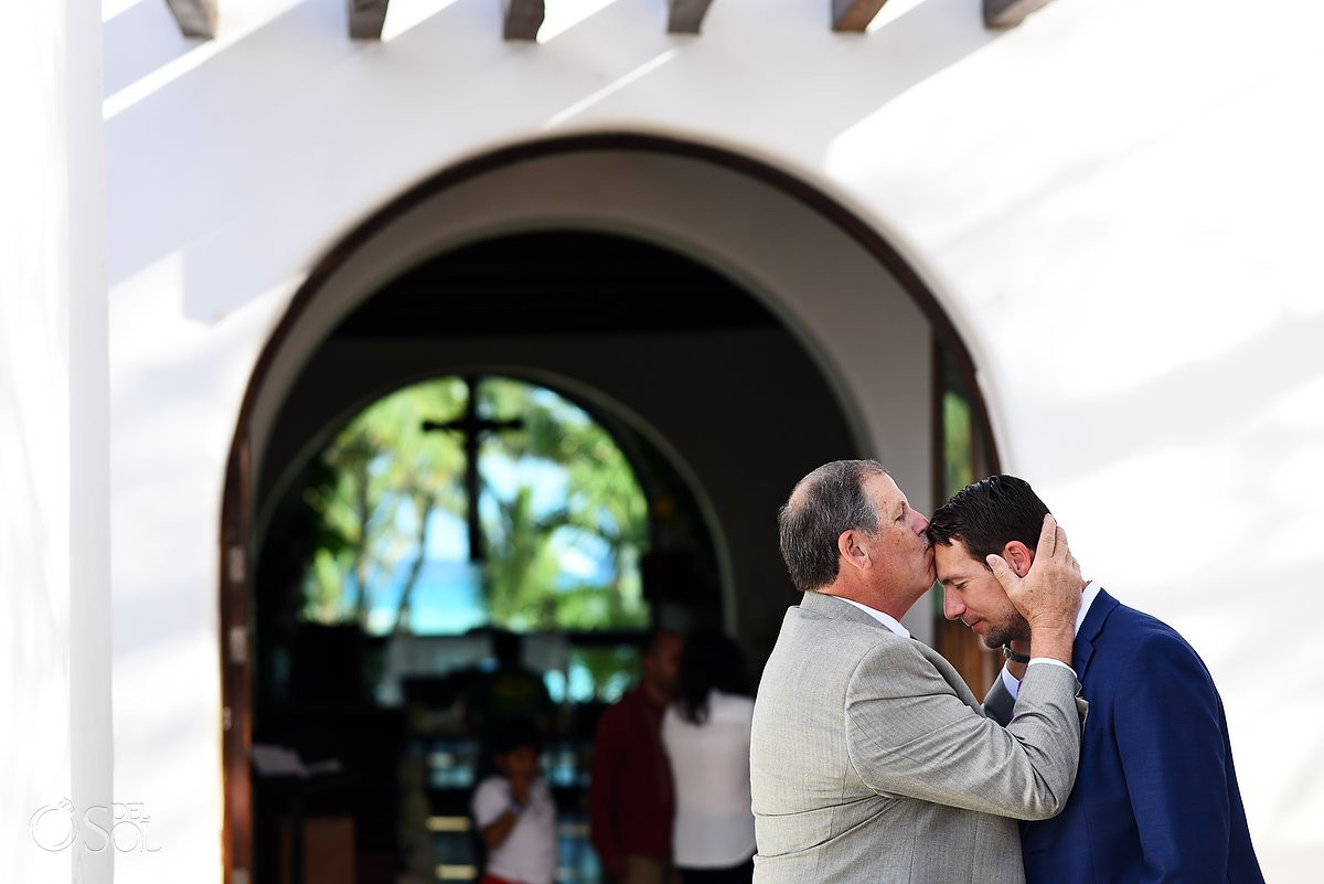 Father kissing the groom Nuestra seńora del Carmen Playa del Carmen Mexico